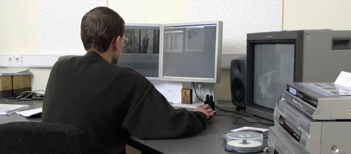 young man at 80s computer