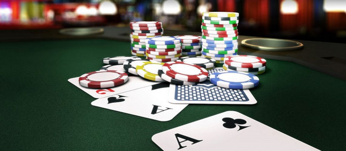 poker ships and cards on poker table
